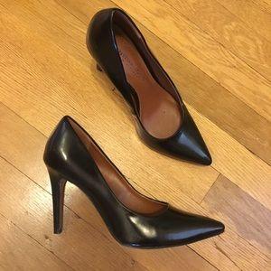 Black pointy toe pumps